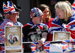 Royal fans wait to watch a rehearsal of the royal wedding in Windsor, England, Thursday, May 17, 2018. Preparations are being made in the town ahead of the wedding of Britain's Prince Harry and Meghan Markle that will take place in Windsor on Saturday May 19. (AP Photo/Frank Augstein)