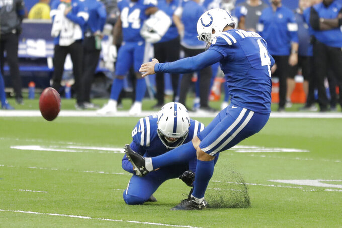 FILE - In this Oct. 27, 2019, file photo, Indianapolis Colts kicker Adam Vinatieri (4) kicks the game winning field goal out of the hold of Rigoberto Sanchez (8) during the second half of an NFL football game against the Denver Broncos in Indianapolis. The Colts now have two kickers under contract for next season while the NFL's career scoring leader, Adam Vinatieri, remains a free agent. On Wednesday, April 29, 2020, team officials announced they had signed 10 undrafted rookies including Rodrigo Blankenship of Georgia, one of last season's top college kickers. (AP Photo/Michael Conroy, File)