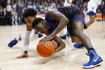 DePaul's Jalen Coleman-Lands, right, and Villanova's Justin Moore battle for a loose ball during the first half of an NCAA college basketball game, Tuesday, Jan. 14, 2020, in Villanova, Pa. (AP Photo/Matt Slocum)