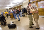 In this Feb. 26, 2016 photo, Chuck and Sandy Cave, of Timberville, Va. dance along to the music during a Friday night bluegrass jam session at the New Market Community Center in New Market, Va. Since March 2020 during the COVID-19 pandemic, musicians have adapted to streaming shows online and collaborating with distant artists for songs in solidarity, but revenue and environmental changes have caused some music makers to reflect on and experiment with their artistic intentions. (Daniel Lin/Daily News-Record via AP)