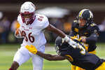 Elon's Caleb Ogunmola (86) is tackled by Appalachian State's Shaun Jolly (3), who is followed by Madison Cone during the second quarter of an NCAA college football game in Boone, N.C., Saturday, Sept. 18, 2021. (Kenneth Ferriera/News & Record via AP)