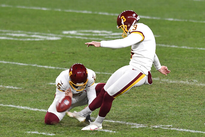 Washington Football Team kicker Dustin Hopkins (3) boots a field goal during the first half of an NFL football game against the Pittsburgh Steelers in Pittsburgh, Monday, Dec. 7, 2020. (AP Photo/Barry Reeger)