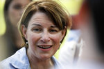 Democratic presidential candidate Sen. Amy Klobuchar speaks to reporters during the West Des Moines Democrats' annual picnic, Wednesday, July 3, 2019, in West Des Moines, Iowa. (AP Photo/Charlie Neibergall)