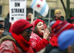 Ruth Arnold, center, a preschool special education teacher at Philip Rogers Elementary School in Chicago, rallies with other striking Chicago Teachers Union members and their supporters at Roosevelt Road and Halsted Street in Chicago on Wednesday, Oct. 30, 2019. (Terrence Antonio James/Chicago Tribune via AP)