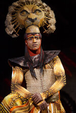 """This image released by Disney Theatrical Productions shows L. Steven Taylor as Mufasa during a North American tour performance of """"The Lion King."""" (Joan Marcus/Disney Theatrical Productions via AP)"""