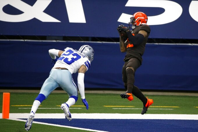 Dallas Cowboys safety Darian Thompson, left, is unable to prevent Cleveland Browns wide receiver Odell Beckham Jr. (13) from catching a touchdown pass thrown by wide receiver Jarvis Landry in the first half of an NFL football game in Arlington, Texas, Sunday, Oct. 4, 2020. (AP Photo/Michael Ainsworth)