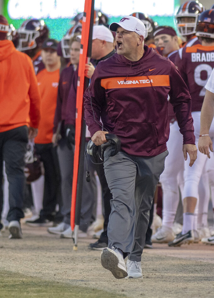 Virginia Tech head coach Justin Fuente reacts after believing a holding call was missed by officials following a pass intended for Damon Hazelton during the Boston College Virginia Tech Football game in Blacksburg, Va., Saturday, Nov. 3, 2018. (AP Photo/Matt Bell)
