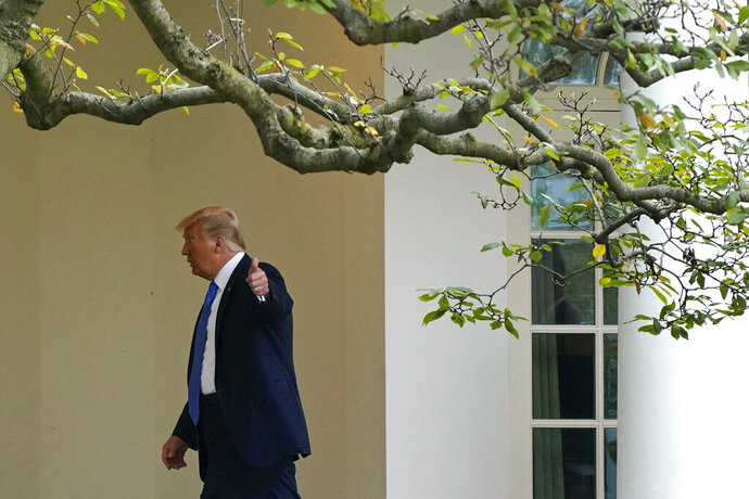 President Donald Trump gestures to members of the press as he walks to the Oval Office of the White House after visiting the Supreme Court to pay respects to Justice Ruth Bader Ginsburg, Thursday, Sept. 24, 2020, in Washington. (AP Photo/Patrick Semansky)