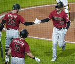 Arizona Diamondbacks' Pavin Smith (26) is greeted by Josh VanMeter (19) and Christian Walker (53) after hitting a solo home run against the Pittsburgh Pirates during the sixth inning of a baseball game Wednesday, Aug. 25, 2021, in Pittsburgh. (AP Photo/Keith Srakocic)