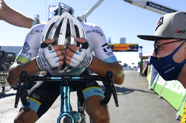 Kazakhstan's Alexey Lutsenko rests after winning the sixth stage of the Tour de France cycling race over 191 kilometers from Le Teil to Mt. Aigoual Thursday, Sept. 3, 2020. (Sebastien Nogier, Pool via AP)