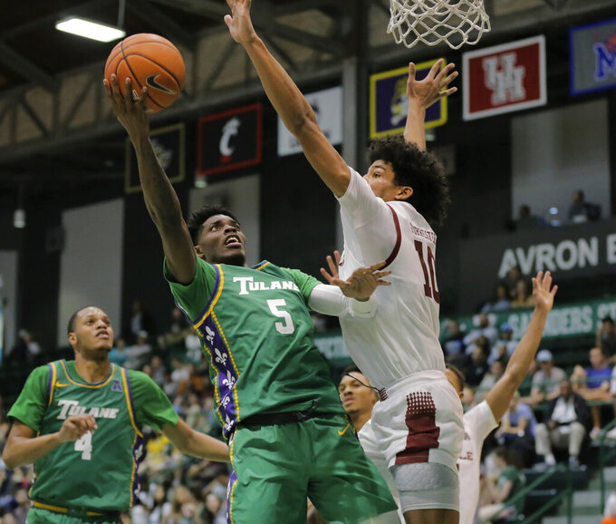 Tulane guard Teshaun Hightower (5) is guarded by Temple forward Jake Forrester (10) during the first half of an NCAA college basketball game in New Orleans on Wednesday, Feb. 12, 2020. (David Grunfeld/The Advocate via AP)