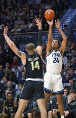 Villanova forward Jeremiah Robinson-Earl (24) takes a three point shot over Army forward Matt Wilson (14) during the first half of an NCAA college basketball game Tuesday, Nov. 5, 2019, in Villanova, Pa. (AP Photo/Laurence Kesterson)