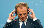 Outgoing President of the European Council and new President of the European People's Party Donald Tusk listens to a question during a press conference during the European Peoples Party (EPP) congress in Zagreb, Croatia, Thursday, Nov. 21, 2019. (AP Photo/Darko Vojinovic)