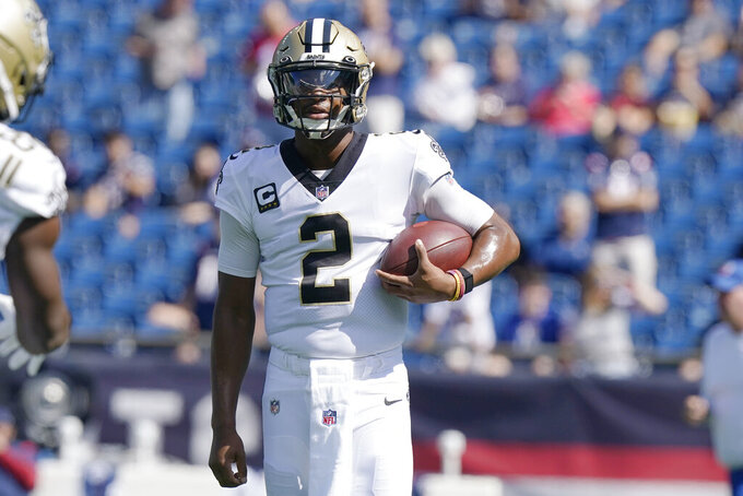New Orleans Saints quarterback Jameis Winston (2) warms up prior to an NFL football game between the Saints and New England Patriots, Sunday, Sept. 26, 2021, in Foxborough, Mass. (AP Photo/Steven Senne)