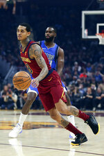 Cleveland Cavaliers' Jordan Clarkson (8) drives around Dallas Mavericks' Tim Hardaway Jr. in the first half of an NBA basketball game, Sunday, Nov. 3, 2019, in Cleveland. (AP Photo/Ron Schwane)