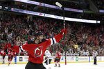 New Jersey Devils center Kevin Rooney celebrates after scoring his first career goal during the second period of an NHL hockey game against the Chicago Blackhawks, Monday, Jan. 14, 2019, in Newark, N.J. (AP Photo/Julio Cortez)