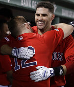 Boston Red Sox's J.D. Martinez celebrates his two-run home run with Brock Holt (12) during the fourth inning of the team's baseball game against the Los Angeles Angels at Fenway Park, Friday, Aug. 9, 2019, in Boston. (AP Photo/Elise Amendola)