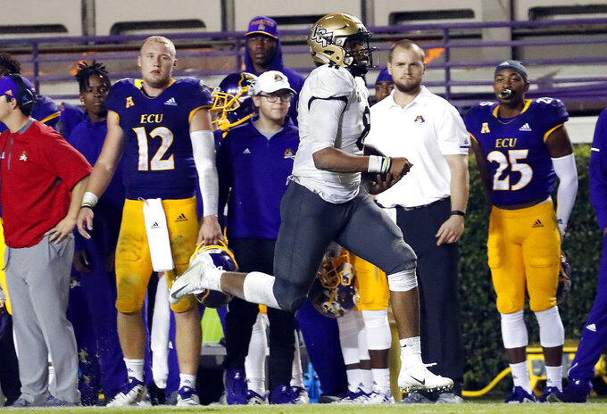 Central Florida's Darriel Mack Jr. (8) runs the ball during the second half of an NCAA college football game against East Carolina, in Greenville, N.C., Saturday, Oct. 20, 2018. UCF won 37-10. (AP Photo/Karl B DeBlaker)