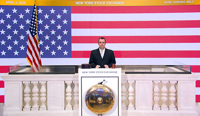 In this photo taken from video provided by the New York Stock Exchange, Robert Glorioso, Chief, Building Engineering Operations, rings the opening bell at the NYSE, Thursday, April 2, 2020. Stocks are wavering between small gains and losses early Thursday after a report showed a record number of Americans lost their jobs last week due to the coronavirus outbreak. (New York Stock Exchange via AP)