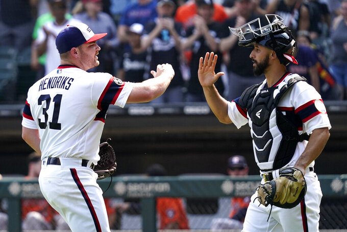 Chicago White Sox relief pitcher Liam Hendriks, left, celebrates with catcher Seby Zavala after they defeated the Houston Astros in a baseball game in Chicago, Sunday, July 18, 2021. (AP Photo/Nam Y. Huh)