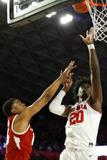 Georgia's Rayshaun Hammonds (20) shoots while defended by Arkansas guard Jalen Harris (5) during an NCAA college basketball game in Athens, Ga., Saturday, Feb. 29, 2020. (Joshua L. Jones/Athens Banner-Herald via AP)