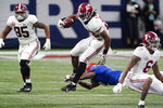 Alabama running back Najee Harris (22) runs against Florida during the second half of the Southeastern Conference championship NCAA college football game, Saturday, Dec. 19, 2020, in Atlanta. (AP Photo/John Bazemore)