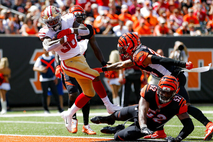 San Francisco 49ers running back Jeffrey Wilson (30) scores a touchdown during the first half an NFL football game against the Cincinnati Bengals, Sunday, Sept. 15, 2019, in Cincinnati. (AP Photo/Gary Landers)