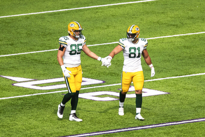 FILE - In this Sunday, Sept. 13, 2020 file photo, Green Bay Packers tight end Robert Tonyan (85), left, and tight end Josiah Deguara (81) celebrate after gaining a first down against the Minnesota Vikings in the second quarter during an NFL football game in Minneapolis. Green Bay Packers tight end Josiah Deguara says his long recovery from a torn anterior cruciate ligament took a toll on him mentally as well as physically. (AP Photo/David Berding, File)
