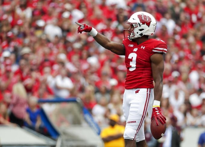 """FILE - In this Sept. 7, 2019, file photo, Wisconsin's Kendric Pryor celebrates a first down during the first half of an NCAA college football game against Central Michigan, in Madison, Wis. Illinois believes its upset of Wisconsin last year showed how far its program has come. The oddsmakers are reminding the Illini how far they still have to go. """"Obviously last year didn't go the way we wanted it to, but we try not to dwell too much in the past,"""" Wisconsin wide receiver Kendric Pryor said.(AP Photo/Morry Gash, File)"""