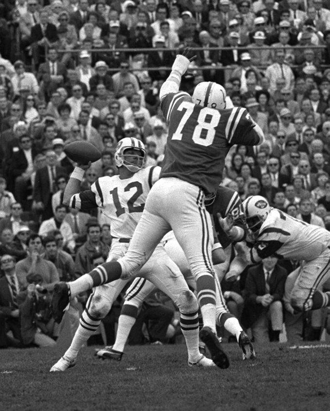 FILE - In this Jan. 12, 1969, file photo, Bubba Smith (78) of the Baltimore Colts leaps in a vain attempt to block a pass from New York Jets quarterback Joe Namath in Super Bowl III in Miami, Fla. The Jets won 16-7. Broadway Joe was the No. 1 overall pick in the AFL draft in 1965 and went on to deliver the franchise its only Super Bowl victory - and still its only appearance in the big game. (AP Photo/File)