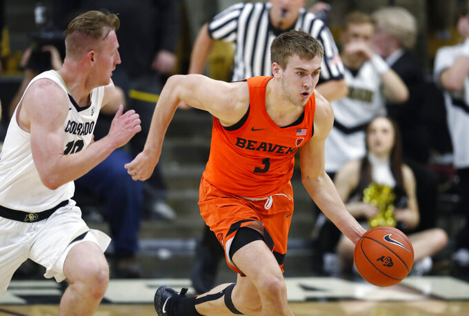 Oregon State forward Tres Tinkle, right, drives downcourt after picking up the ball with Colorado forward Alexander Strating in pursuit in the first half of an NCAA college basketball game Thursday, Jan. 31, 2019, in Boulder, Colo. (AP Photo/David Zalubowski)