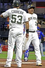 Pittsburgh Pirates' Jose Osuna, right, is greeted by Melky Cabrera (53) after they both scored on a triple by Pablo Reyes off Chicago Cubs starting pitcher Jose Quintana during the first inning of a baseball game in Pittsburgh, Thursday, Sept. 26, 2019. (AP Photo/Gene J. Puskar)