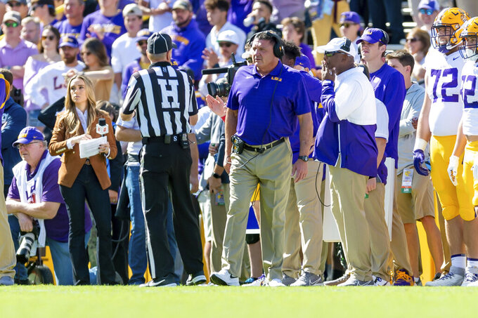 LSU head coach Ed Orgeron coaches against Florida in an NCAA college football game, Saturday, Oct. 16, 2021, in Baton Rouge, La. LSU and coach Orgeron have agreed to part ways after this season, according to multiple media reports Sunday, Oct. 17, 21 months after he led the Tigers to a national championship with what is considered one of the greatest teams in college football history. (Scott Clause/The Daily Advertiser via AP)
