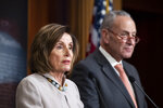 House Speaker Nancy Pelosi of Calif., joined by Senate Minority Leader Chuck Schumer of N.Y., speaks during a news conference, on Capitol Hill, Tuesday, Feb.11, 2020, in Washington. (AP Photo/Alex Brandon)