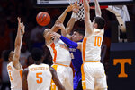 Kentucky forward Nick Richards (4) passes the ball off as he's defended by Tennessee forward Grant Williams (2), forward John Fulkerson (10), guard Admiral Schofield (5) and guard Lamonte Turner (1) during the second half of an NCAA college basketball game Saturday, March 2, 2019, in Knoxville, Tenn. Tennessee won 71-52. (AP Photo/Wade Payne)
