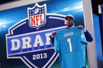 FILE - In this April 25, 2013, file photo, Dion Jordan stands with the team jersey after being selected third overall by the Miami Dolphins in the first round of the NFL football draft in New York. Jordan struggled with substance abuse, saw limited playing time and totaled three sacks in two seasons with the Dolphins before they released him in 2017. (AP Photo/Jason DeCrow, File)