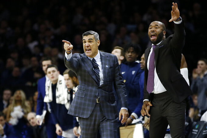 FILE - Villanova head coach Jay Wright, left, and assistant coach Kyle Neptune yell to their team during the second half of an NCAA college basketball game against Creighton in Philadelphia, in this Saturday, Feb. 1, 2020, file photo. Fordham hired longtime Villanova assistant Kyle Neptune on Tuesday, March 30, 3021, to take over a men's basketball program that has had only two winning seasons since joining the Atlantic 10 Conference in 1995. (AP Photo/Matt Slocum, File)