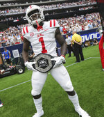 "In this Sept. 1, 2018, photo provided by the Mississippi Athletics Department, Mississippi wide receiver A. J. Brown displays the team's ""Nasty Wide Outs"" belt during an NCAA college football game against Texas Tech in Houston. College football sidelines across the country are featuring everything from wrestling-style robes to boxing gloves as teams try to mimic the success Miami had last season with its turnover chain. (Joshua McCoy, Mississippi Athletics Department via AP)"