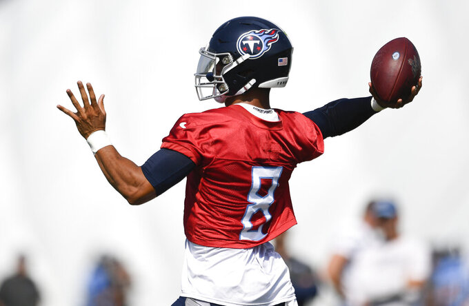 Tennessee Titans NFL football quarterback Marcus Mariota (8) throws a pass during practice at Saint Thomas Sports Park Friday, July 26, 2019, in Nashville, Tenn. (George Walker IV/The Tennessean via AP)