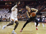 Oklahoma State guard Thomas Dziagwa (4) is pressured by Texas guard Courtney Ramey (3) during the first half of an NCAA college basketball game, Saturday, Feb. 16, 2019, in Austin, Texas. (AP Photo/Eric Gay)