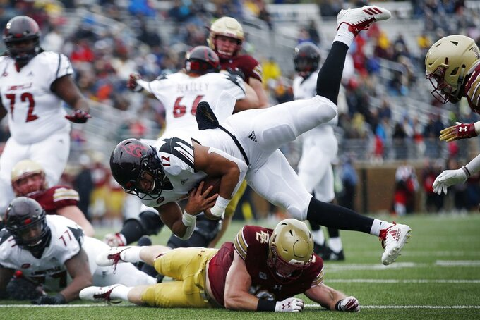 Boston College linebacker Connor Strachan, bottom, stops Louisville running back Trey Smith (12) short of the goal line during the first half of an NCAA college football game in Boston, Saturday, Oct. 13, 2018. (AP Photo/Michael Dwyer)