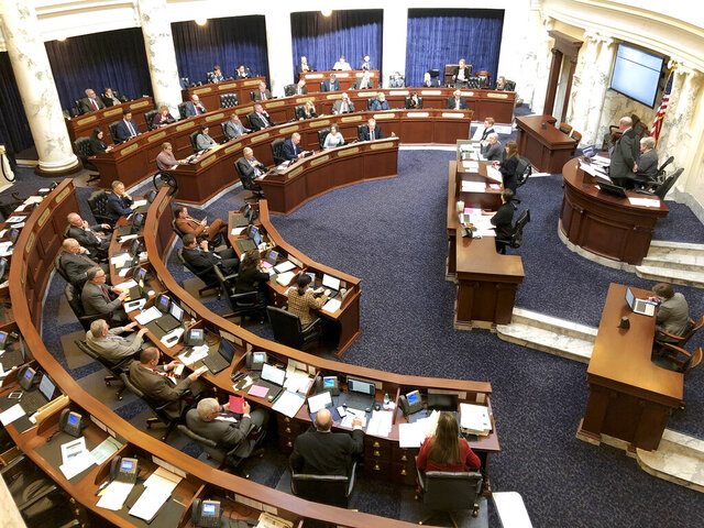 The Idaho House of Representatives debates legislation in the Idaho Statehouse in Boise, Idaho, Thursday, Feb. 27, 2020. Idaho lawmakers moved forward with legislation banning transgender people from changing the sex listed on their birth certificates despite a federal court ruling declaring such a ban unconstitutional. (AP Photo/Keith Ridler)