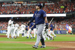Tampa Bay Rays first baseman Ji-Man Choi walks off the field as the Houston Astros celebrate their win in Game 5 of a baseball American League Division Series in Houston, Thursday, Oct. 10, 2019. (AP Photo/Michael Wyke)