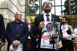 Nihad Awad, right, executive director for the Council on American-Islamic Relations (CAIR), a Muslim civil rights and advocacy organization, speaks during a news conference with Rep. Gerry Connolly, D-Va., left, asking for answers about journalist Jamal Khashoggi's disappearance in Saudi Arabia, Wednesday, Oct. 10, 2018, in front of The Washington Post in Washington. (AP Photo/Jacquelyn Martin)