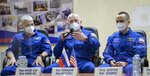 In this image provided by NASA, from left, U.S. astronaut Mark Vande Hei, Russian cosmonauts Oleg Novitsky and Pyotr Dubrov, members of the main crew to the International Space Station (ISS), attend a news conference in the Baikonur Cosmodrome, Kazakhstan, Thursday, April 8, 2021. (Bill Ingalls/NASA via AP