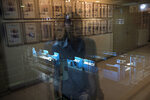 A journalist is reflected in a window at Panorama newspaper in Maracaibo, Venezuela, May 16, 2019. Panorama, which was established in 1914, published a