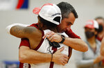 Colgate's head coach Matt Langel hugs Jordan Burns (1) after beating Loyola (Md.), in an NCAA college basketball game in the finals of the Patriot League tournament, Sunday, March 14, 2021, in Hamilton, N.Y. (AP Photo/John Munson)