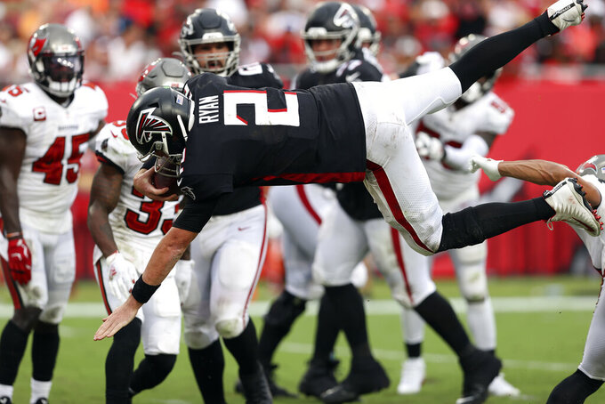 Atlanta Falcons quarterback Matt Ryan (2) dives over on a two-point conversion during the second half of an NFL football game against the Tampa Bay Buccaneer Sunday, Sept. 19, 2021, in Tampa, Fla. (AP Photo/Mark LoMoglio)