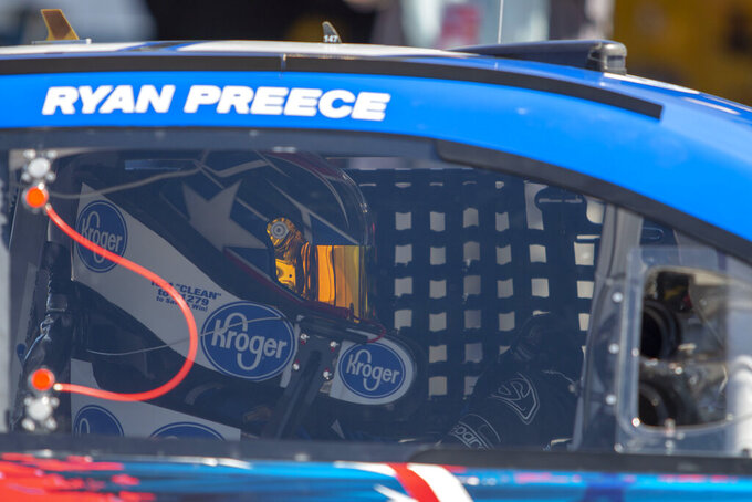 Ryan Preece passes through the garage area during practice at Martinsville Speedway in Martinsville, Va., on Saturday, March 23, 2019. (AP Photo/Matt Bell)