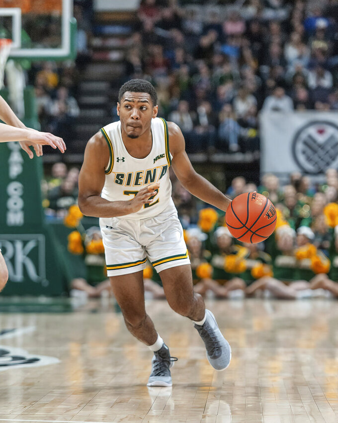 In this Jan. 27, 2019 photo provided by Siena College, Siena point guard Jalen Pickett drives against a Manhattan College defender during their game at Siena College in Loudonville, N.Y. Pickett, who averages 15.5 points and leads the MAAC with 6.4 assists per game, has helped lead Siena into contention for the Metro Atlantic Athletic Conference regular-season title. (Rob Simmons/Siena College via AP)